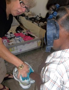 Debby helping one of the kids choose a new pair of shoes in January 2013