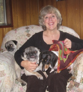 Debby with a few of her favorite things: a quilt and her dogs!