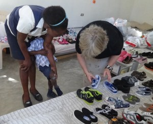 Debby and Gilmine helping a student find a pair of shoes in our little shoe shop
