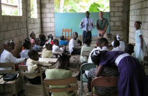 Claudel introduces Jeremy to a classroom full of kids during Sunday School in Carrefour Poy, November 2011