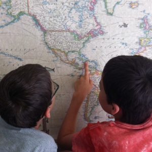 Two of my three boys, finding Haiti on the world map.