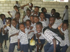 Happy Haitian kids getting food and an education through The Bridge!