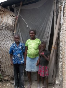 The family of some of our kids in front of their home.