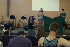 Desiree from That None Shall Perish training our youth team on teaching VBS.