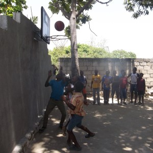 A group of kids enjoying the basketball court!