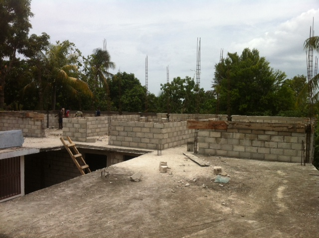 They have begun building classrooms above the existing classrooms to accomodate more classes and students.